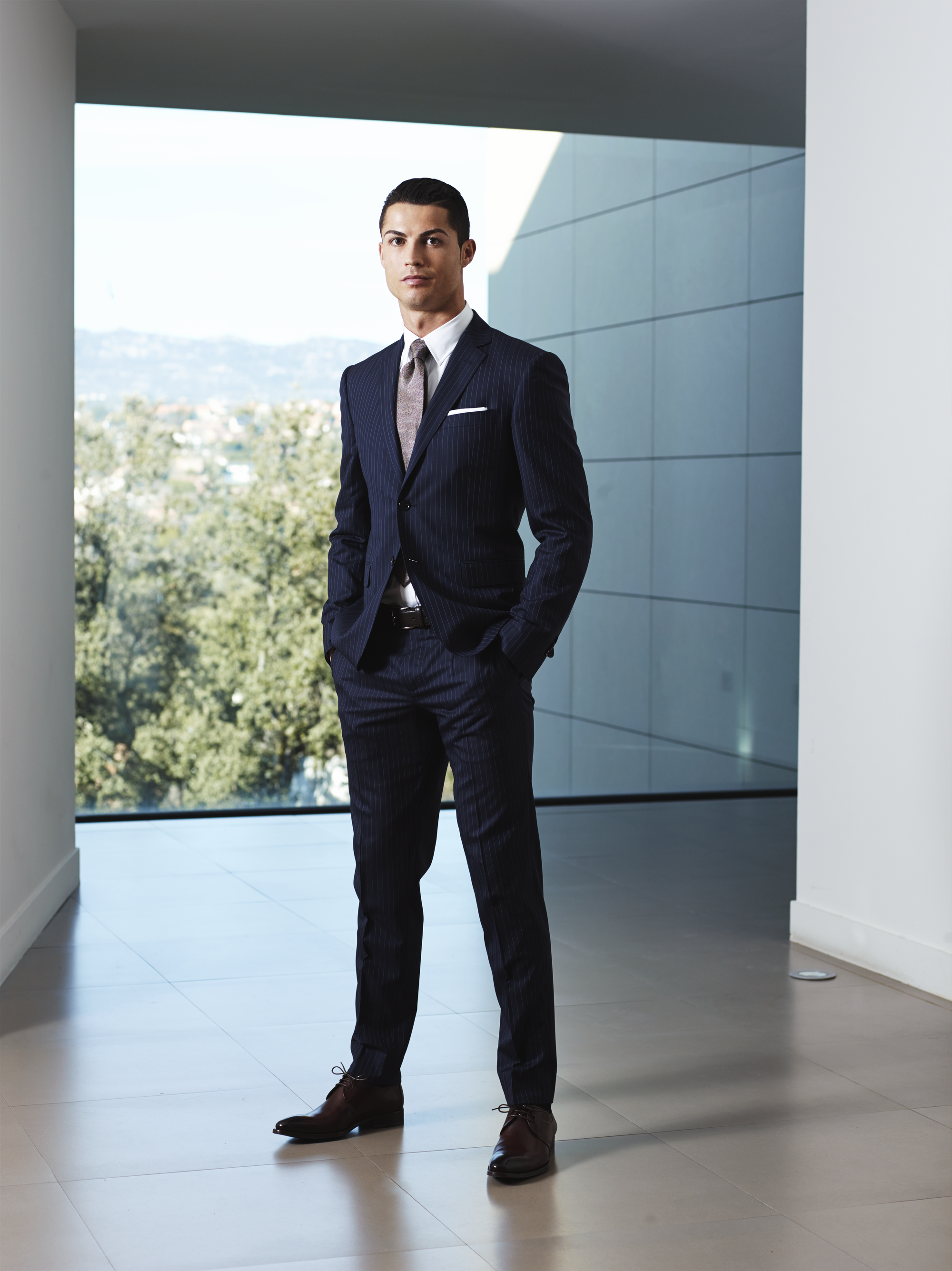 Cristiano Ronaldo In A Sacoor Brothers Blue Suit Cr7