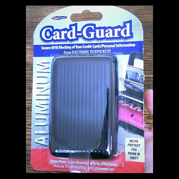 Black Card-Guard Brand new! Never opened. Card-Guard, color black. Protect your cards from having your personal information stolen. Already have one, so selling this one. Bags Wallets