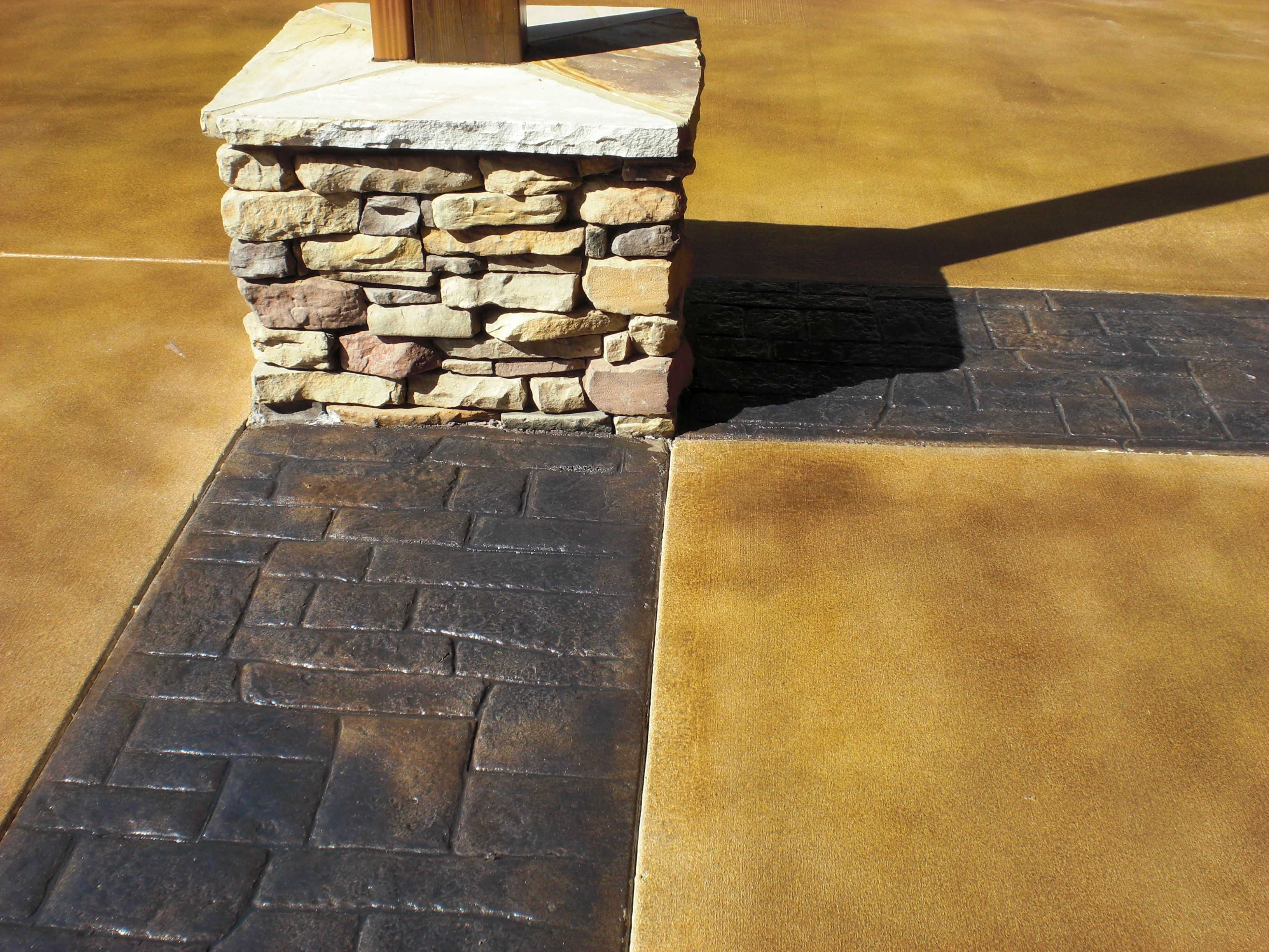 Stamped concrete restoration with semi transparent stains for Black stains on concrete
