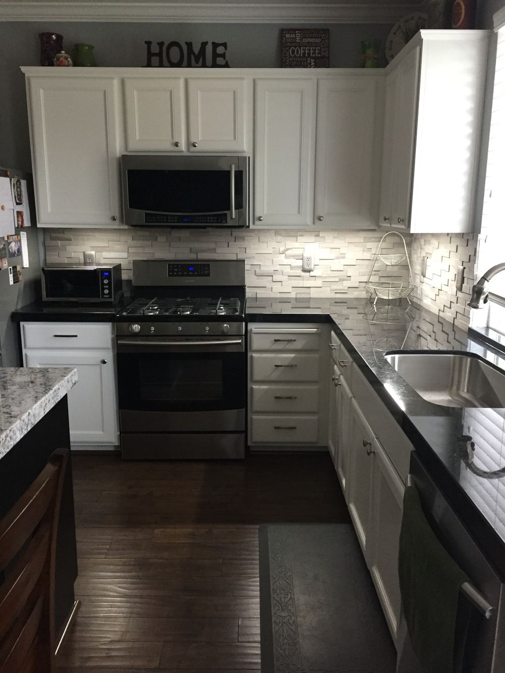 Black granite with a gray stone backsplash for the home for Black kitchen backsplash ideas