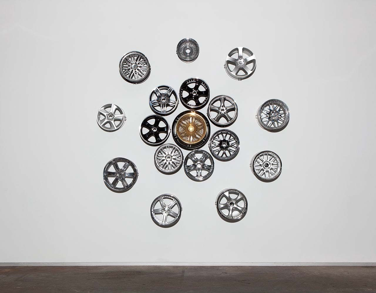 Chrome Lotus (Car Rims on Wall) - Carlos Rolón/Dzine
