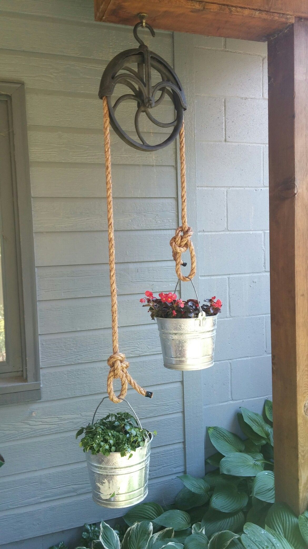 My new upcycle! Old well pulley planter with aluminum buckets! Bowline knots coutesy of DH.