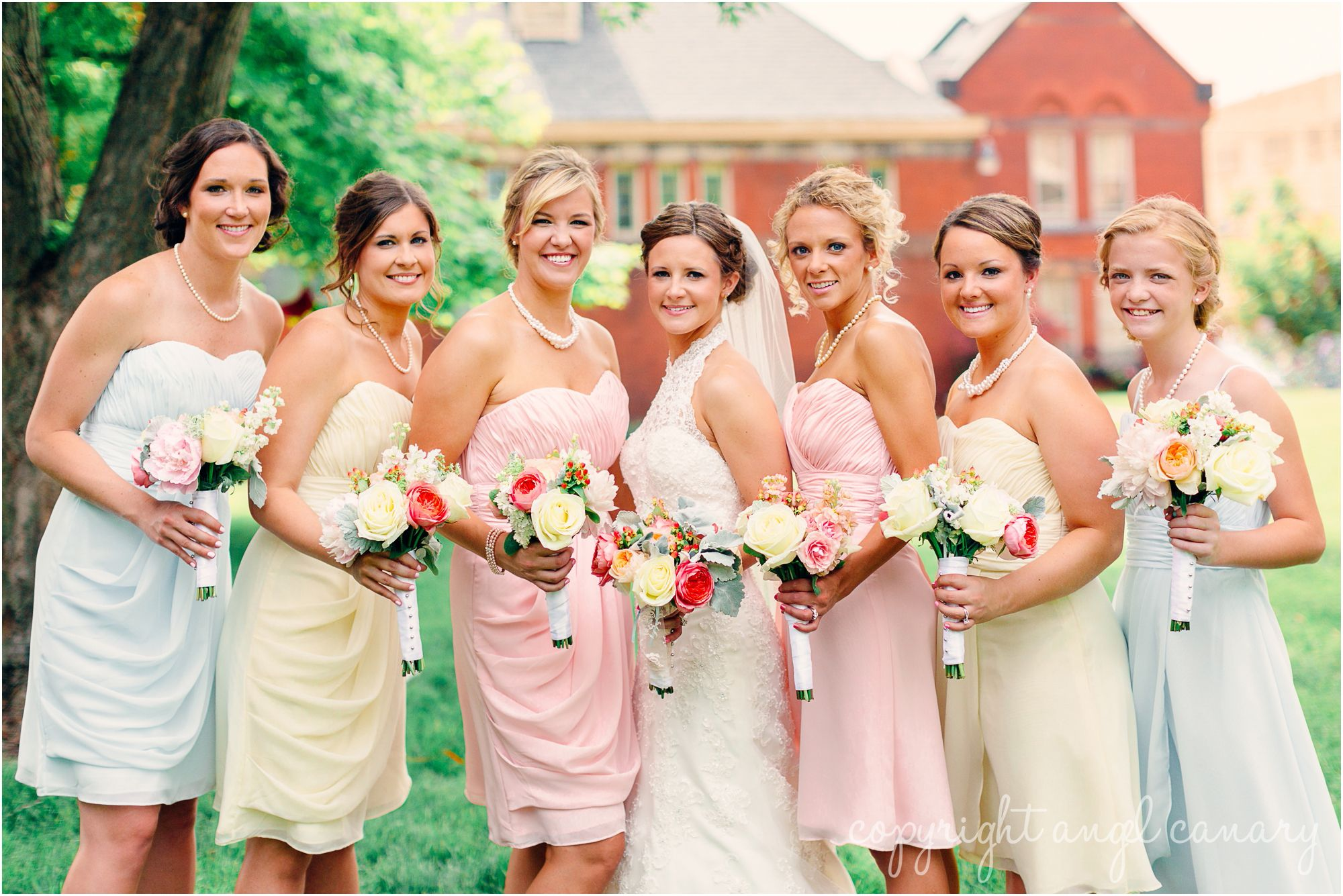 pastel bridesmaid dresses - pink blue yellow   meagan and kevin | married | tea party wedding indianapolis | angel canary photography