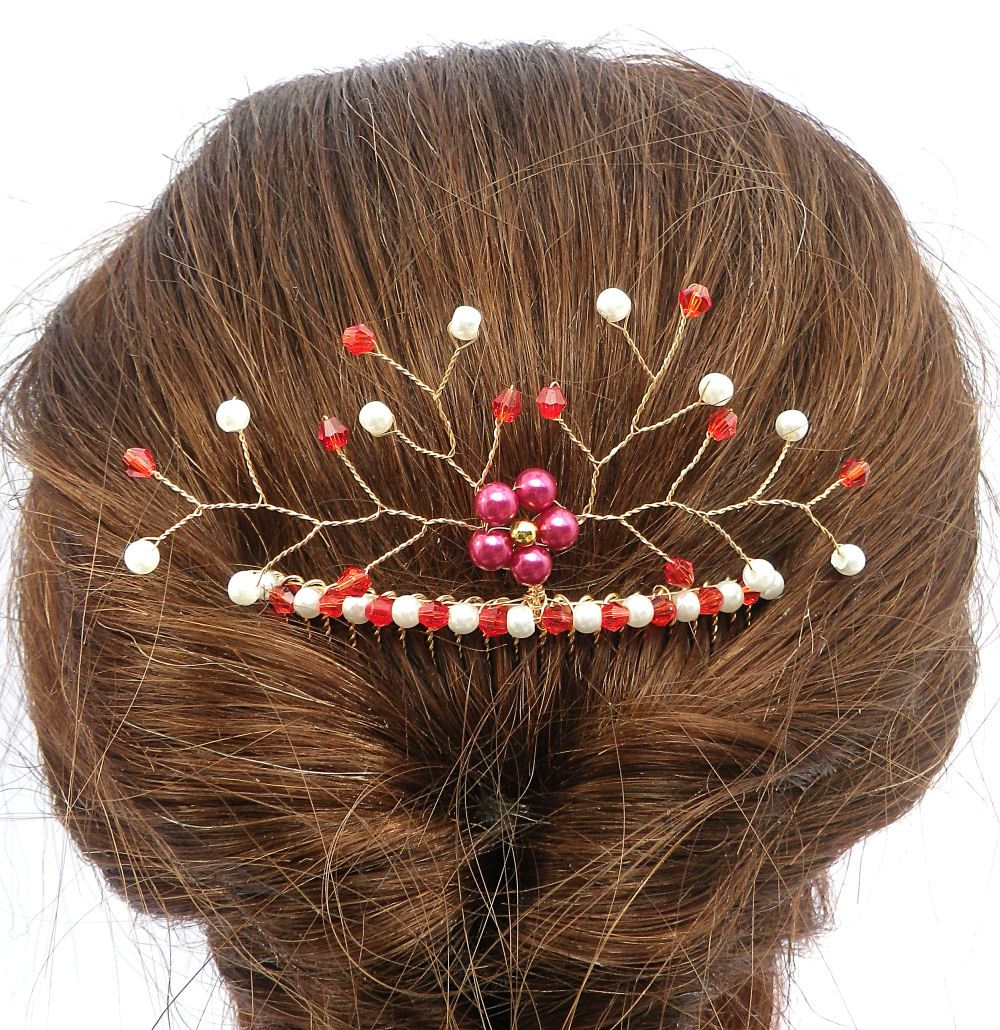This beautiful hair comb adds a splash of colour and nature to ...