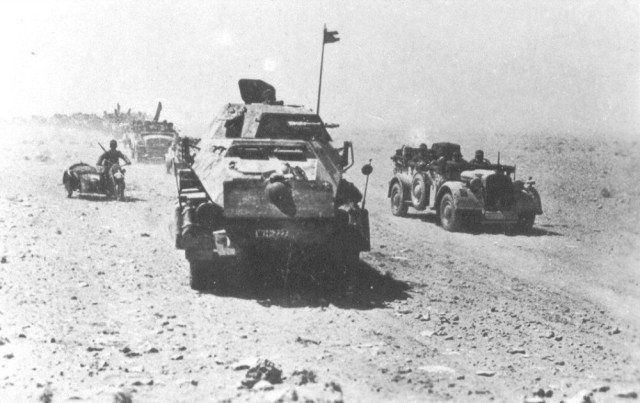 Afrika Korps tank hunters with an Sd.Kfz. 232 armoured car in front [via]