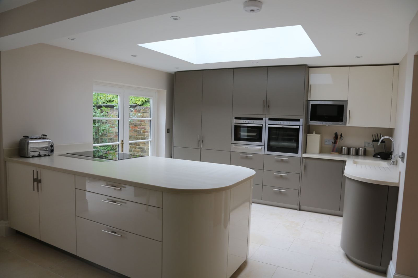 captivating beige gloss kitchen | Gloss Magnolia and Satin Beige by Hacker at The Kitchen ...