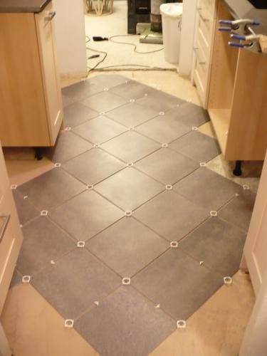 12 in x 12 in coastal gray resilient vinyl tile flooring 30 case 27116 at the home depot for Groutable vinyl tile in bathroom