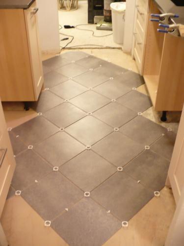 Vinyl Tile Flooring luxury vinyl tile vs hardwood flooring 03 Coastal Gray Resilient Vinyl Tile Flooring 30