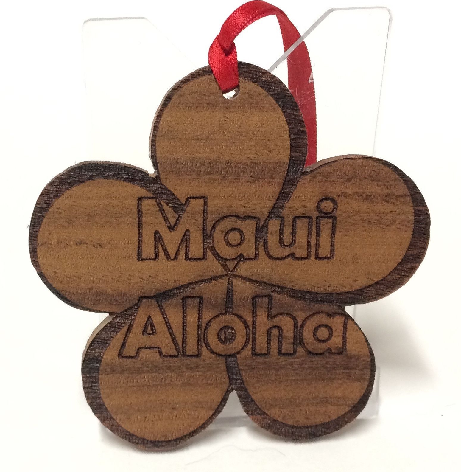 Hawaiian Koa wood Plumeria cutout Christmas ornament crafted by an artist from the Hawaiian Islands.