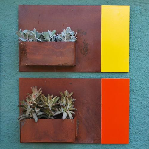 City Planters - Wall planters as art. City Planters add an intriguing dimension to vertical gardening. Hang several on a wall for dramatic impact, or let them shine on their own. A favorite placement for them is the entrance to your home. The planters are constructed of 14 gauge steel with a hand-finished and sealed rust patina, each one is unique with its own pattern and coloration. ($165)