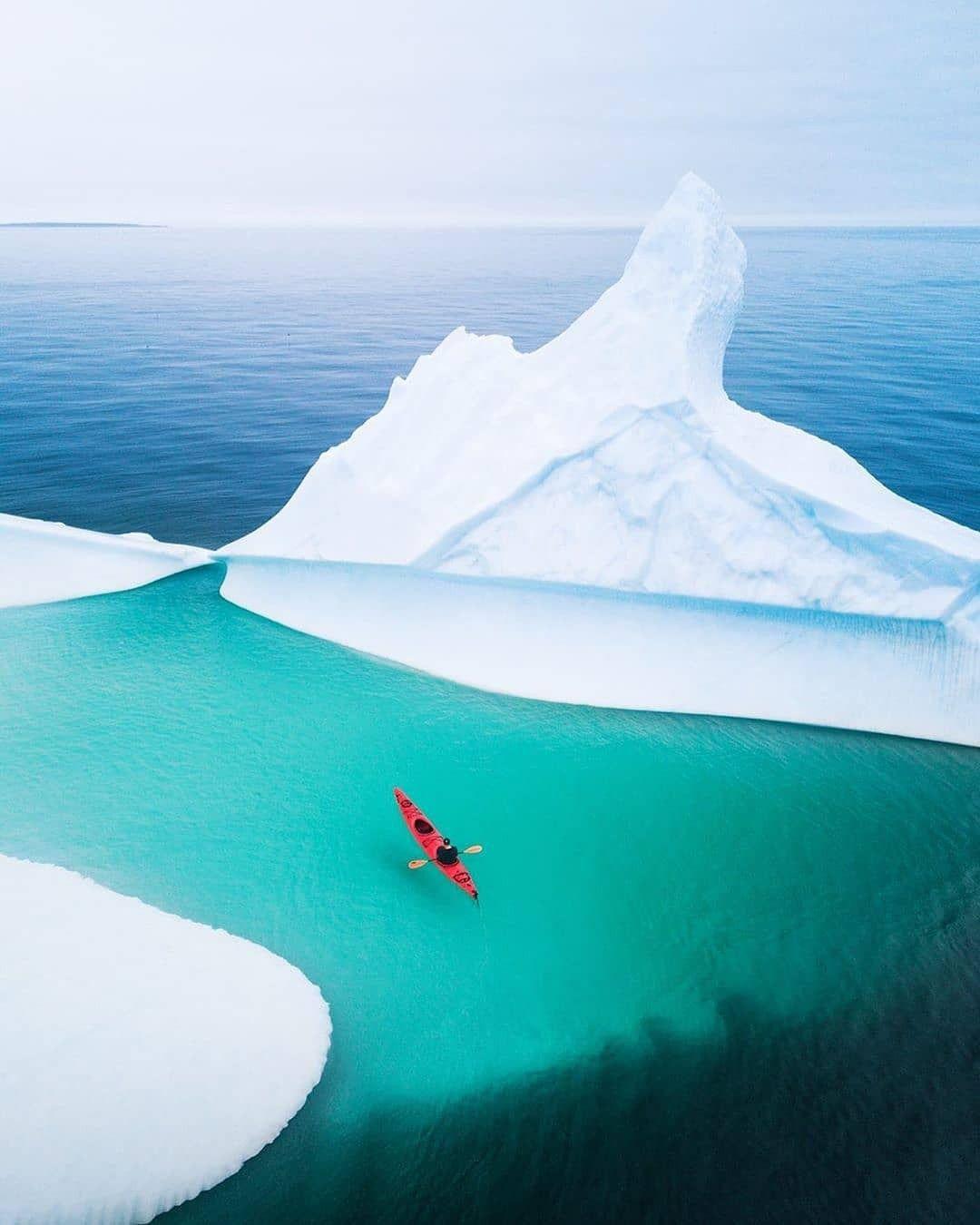 Newfoundland and labrador kayaking around a giant iceberg