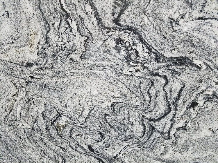 Sensa Waterfall Granite Comes To Us From Brazil The Lovely Granite Offers Waves Of Greys And Black Kitchen Countertops Granite Countertops Kitchen Countertops