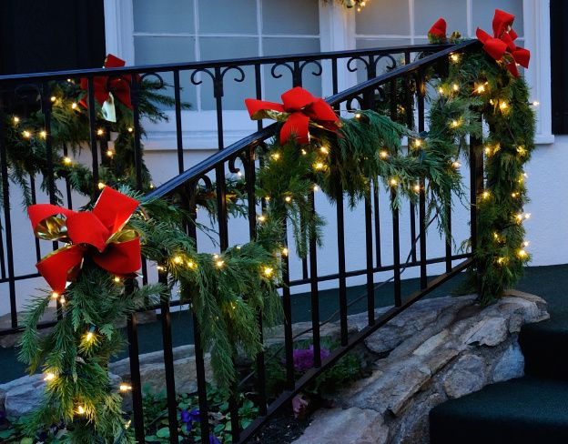 lighted christmas garland porch decorations with red bows christmas porch decorations christmas lights