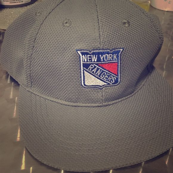"""Grey New York Rangers Fitted Hat Flex fit. NY Rangers """"Rangerstown"""" cap was given to me as a gift. I'm not much of a hat wearer, so this bad boy has never been worn. Perfect condition! Accessories Hats"""