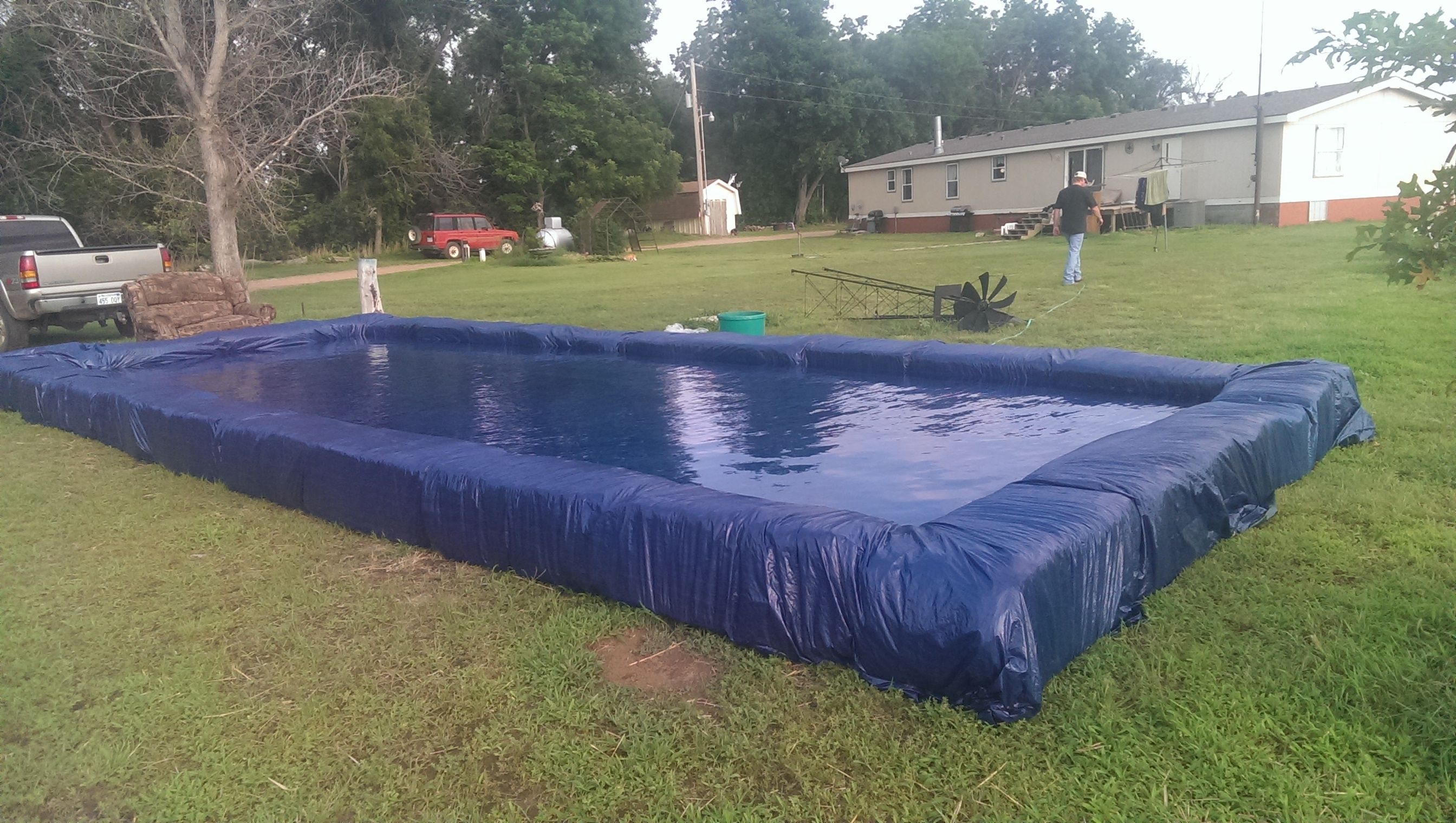 Redneck Pool; built with huge tarp and a lot of hay bales ...