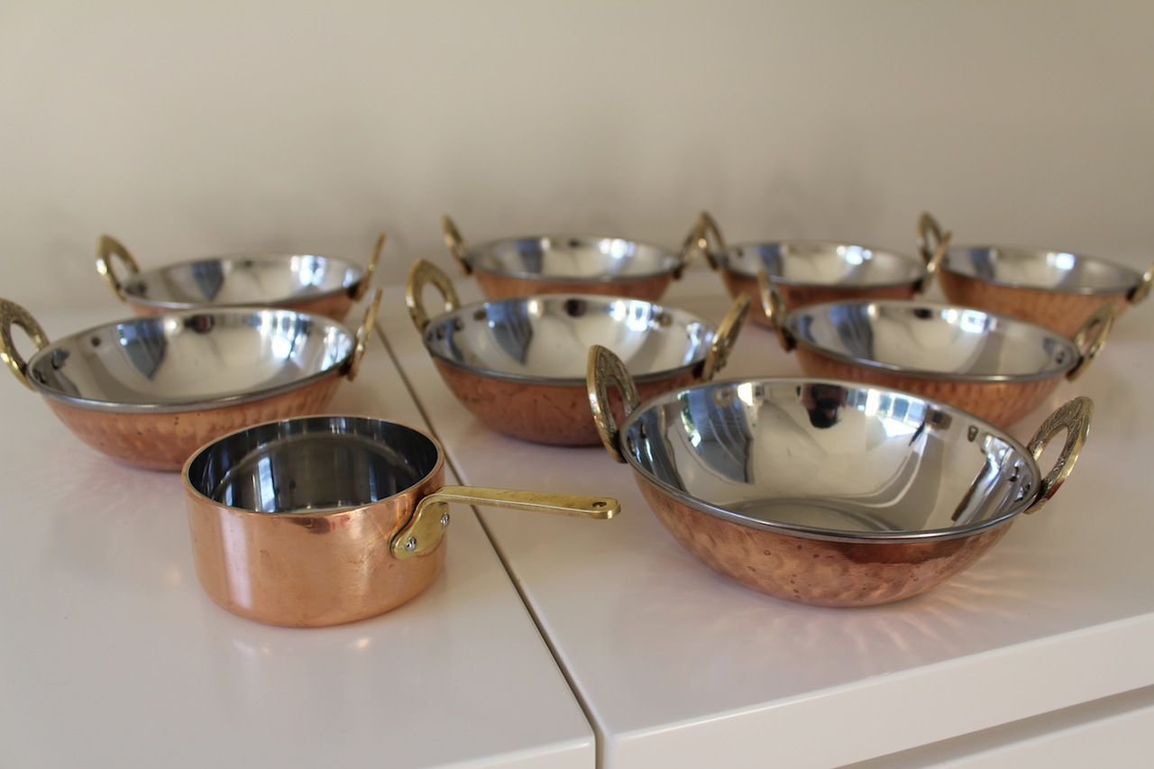 My new copper/stainless bowls. Already used for a home made curry. I used banana leaves on the table.