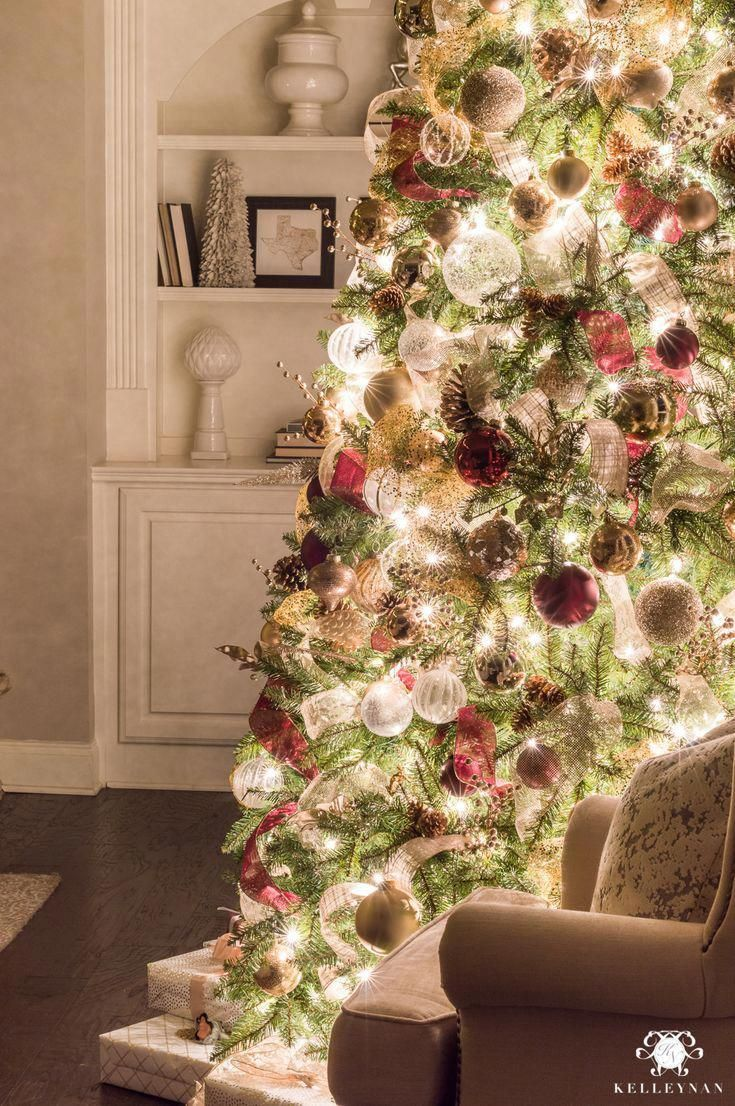 Deep red and white christmas tree decor in the living room