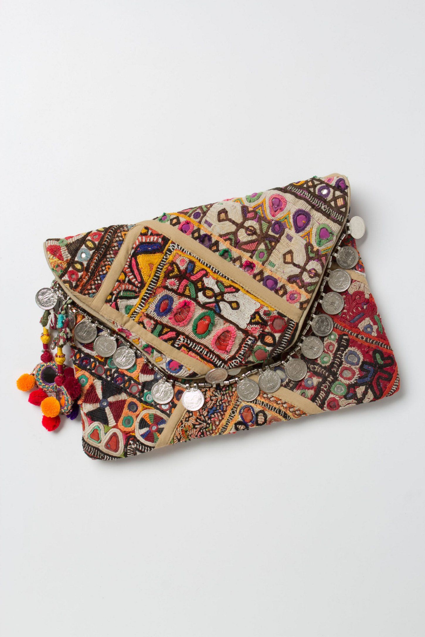 Adele  I ve seen many coin purses like these in my travels.  PranaClutch   Anthropologie b4dcb26bd0432