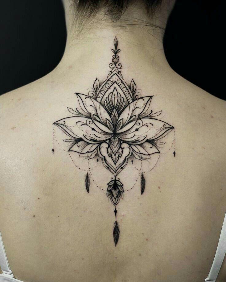 Photo of Lena's mandala lotus flower tattoo, Daryl inked the tattoo on her back in memo…