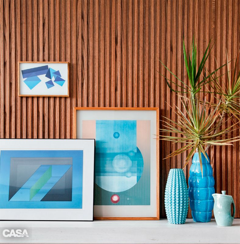 Obsessed with turquoise. Beautiful small vignette with art and vases