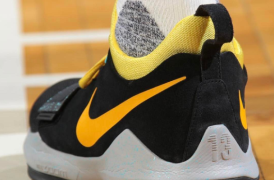 b8477e4e1814 Paul George Wore This New Black And Yellow Nike PG 1 Colorway Last Night