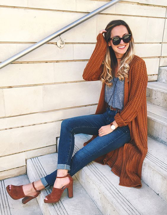 Photo of red-brown knit cardigan with an open front, gray …