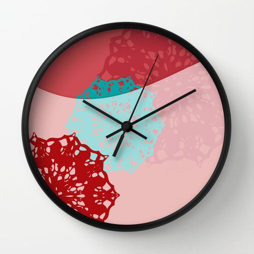 Nice idea for making a pattern on something: cut out snowflakes and spray paint over them. --not a fan of the clock, just the craft idea
