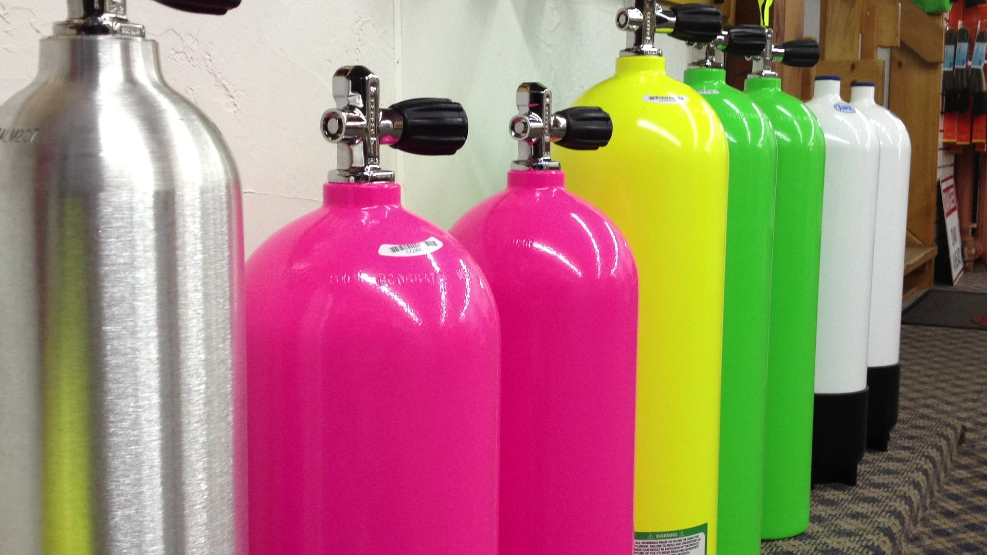 A colorful variety of tanks! Dive in! Bottles decoration