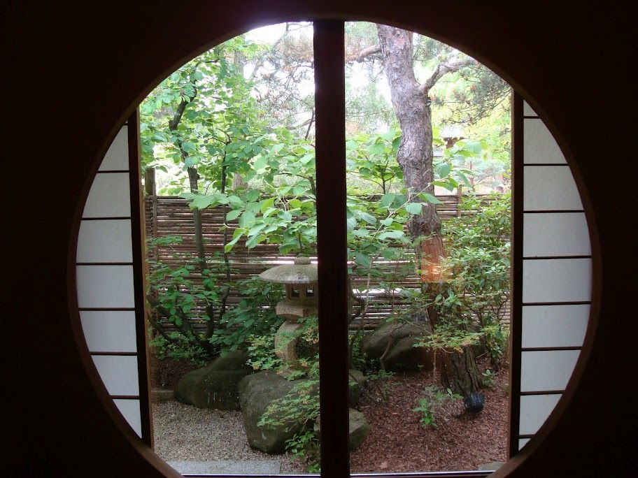Anderson Japanese Garden Guest House gorgeous large round window near entry looks onto private garden