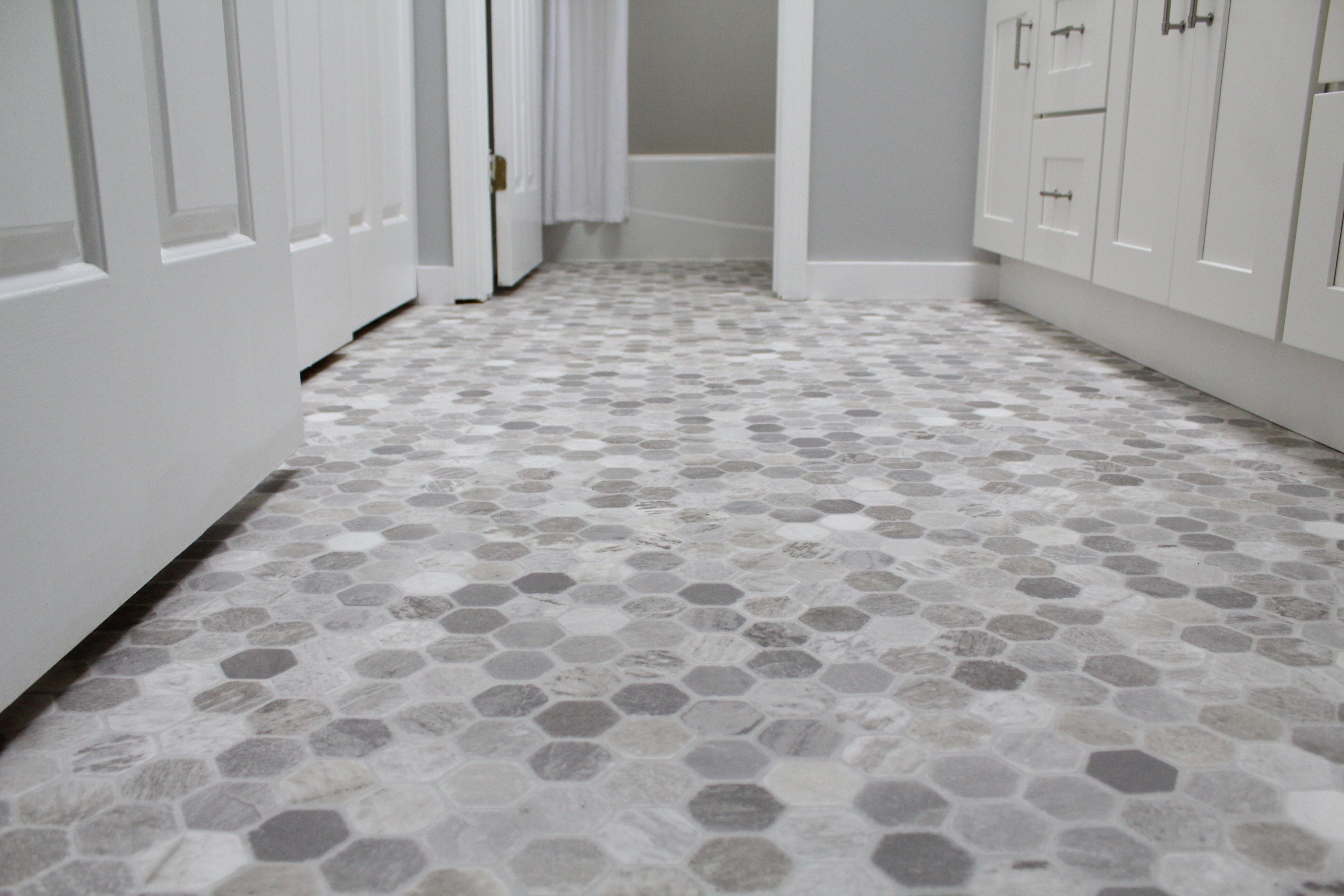 Vinyl flooring with a gray hexagon pattern looks just like ...