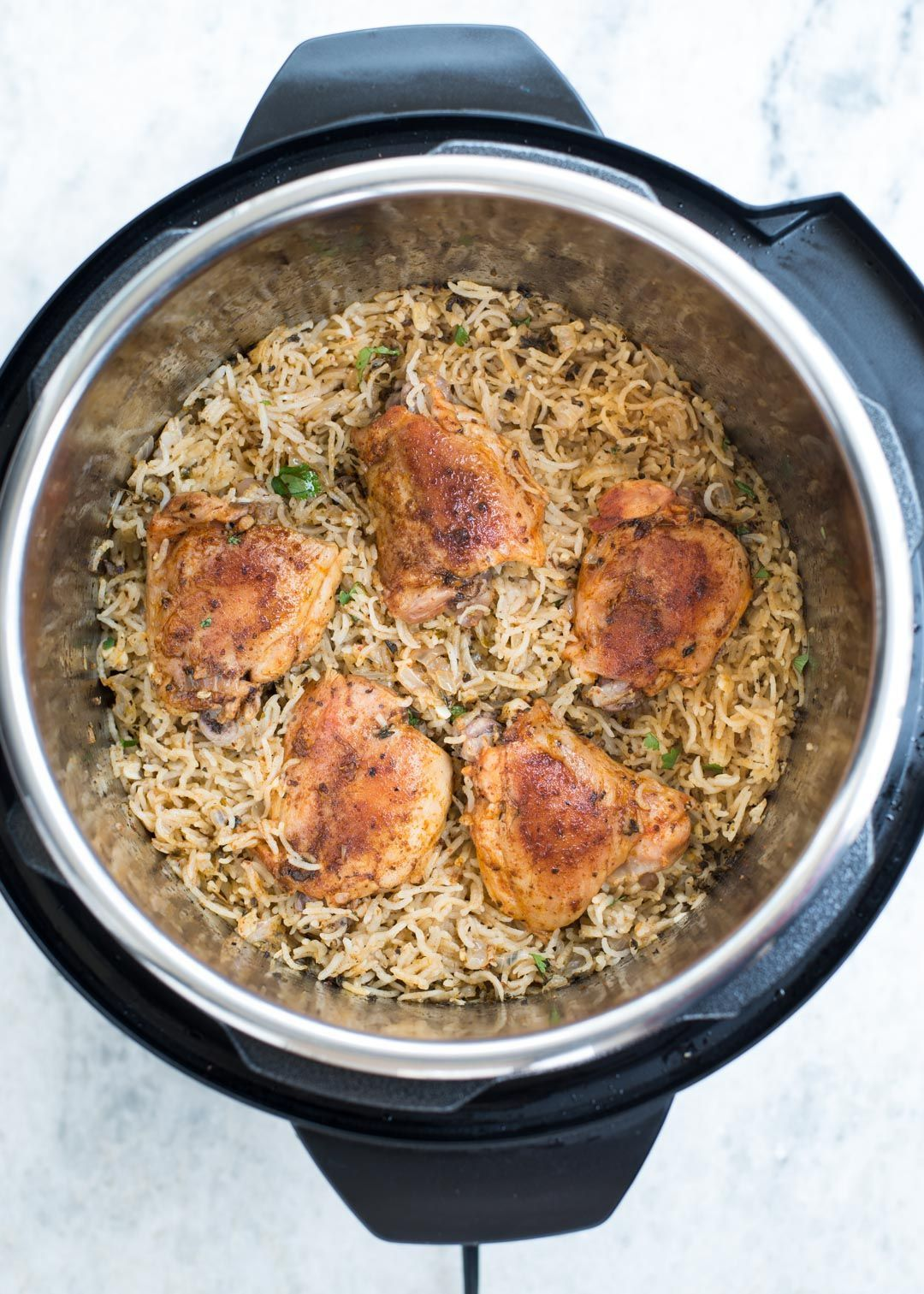 Garlic Herb Chicken and Rice made in the Instant Pot have fluffy buttery rice and Juicy Chicken thighs. This Instant Pot Garlic Herb Chicken and Rice is a wholesome dinner that entire family will love. Herb Chicken and Rice made in the Instant Pot have fluffy buttery rice and Juicy Chicken thighs. This Instant Pot Garlic Herb Chicken and Rice is a wholesome dinner that entire family will love.