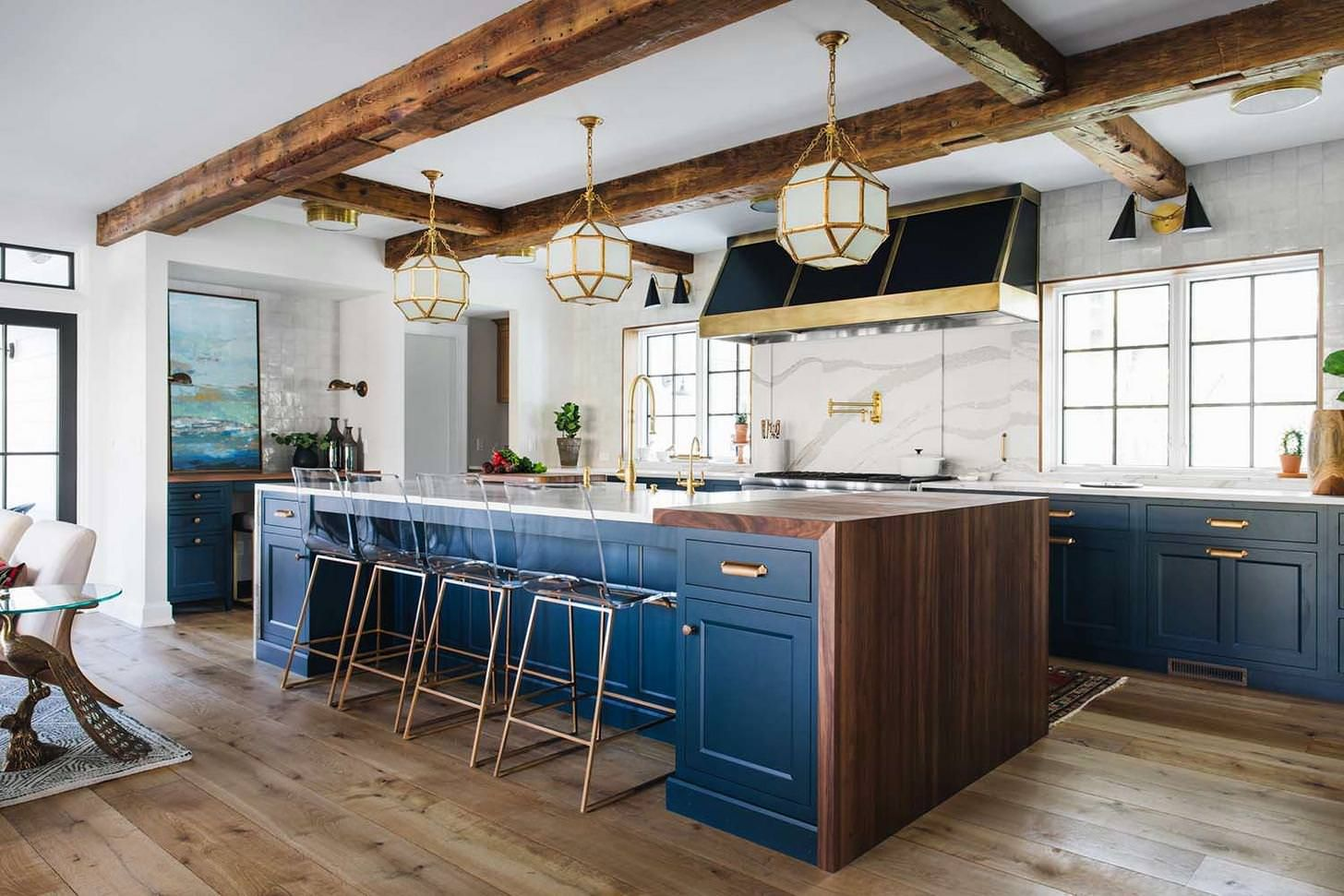 kitchen features exposed joists a large center island with a quartz waterfall counter top and on kitchen island ideas modern farmhouse id=65625