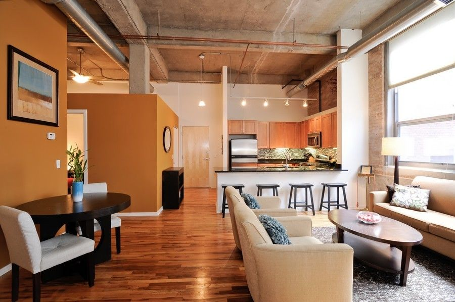 Modern Loft Apartment With Concrete Ceiling Exposed Ductwork Hardwood Floors Brick Breakfast Bar Open Kitchen Mosaic Tile Backsplash And