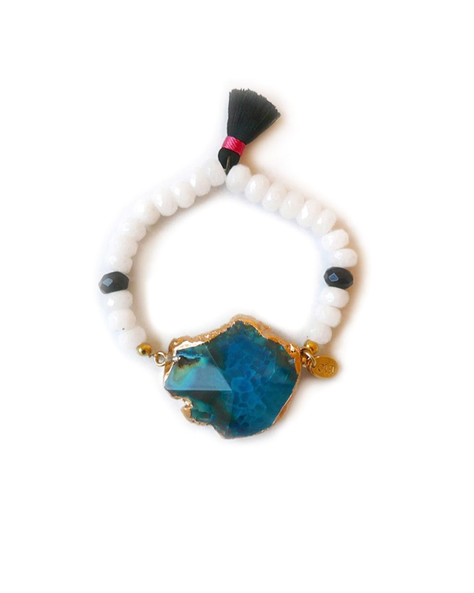 Glacier Bracelet - JewelMint Gorgeous gold plated turquoise agate surrounded by white jade faceted beads with black jade accents and black mini tassel.