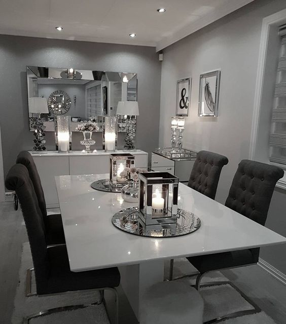 Glam Dining Room With White Table Mirrored Accessories And Dark