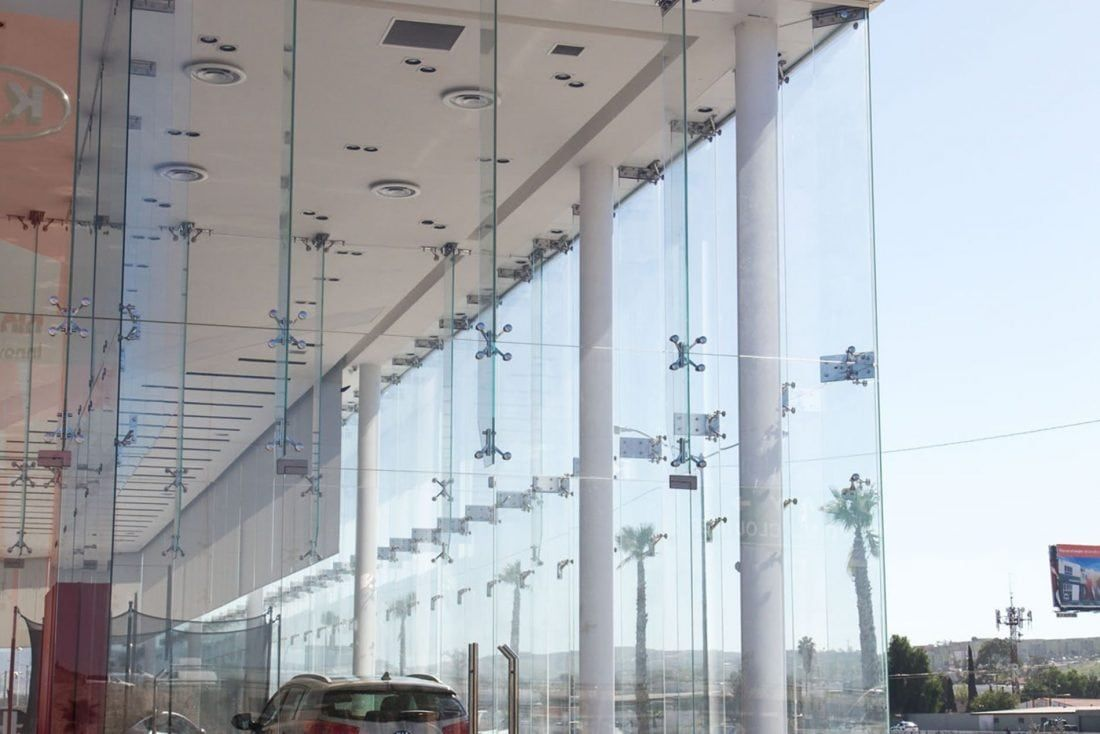 kia store point support glass facade morn turnkey architectural glass partner glass building facade glass facades glass building facade glass facades