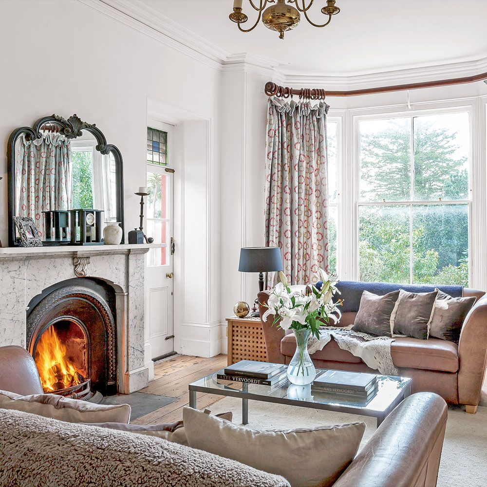 Classic white living room with neutral soft furnishings