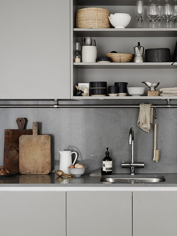 An interesting trend in kitchen design as of late is the movement towards kitchens with open shelving or even little or no storage above the countertop