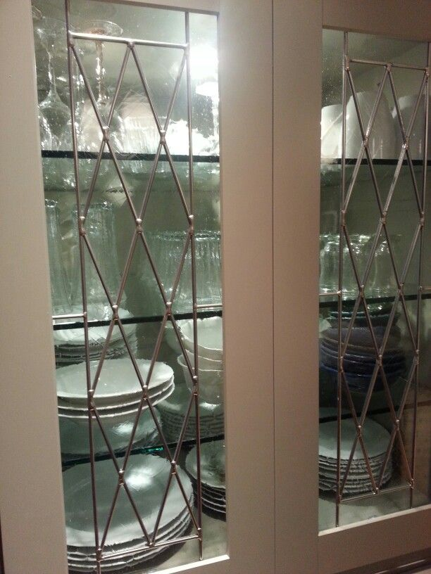 Martha Stewart China cabinet in Ocean Floor and seeded glass. Glass shelves allow the light to shine throughout.