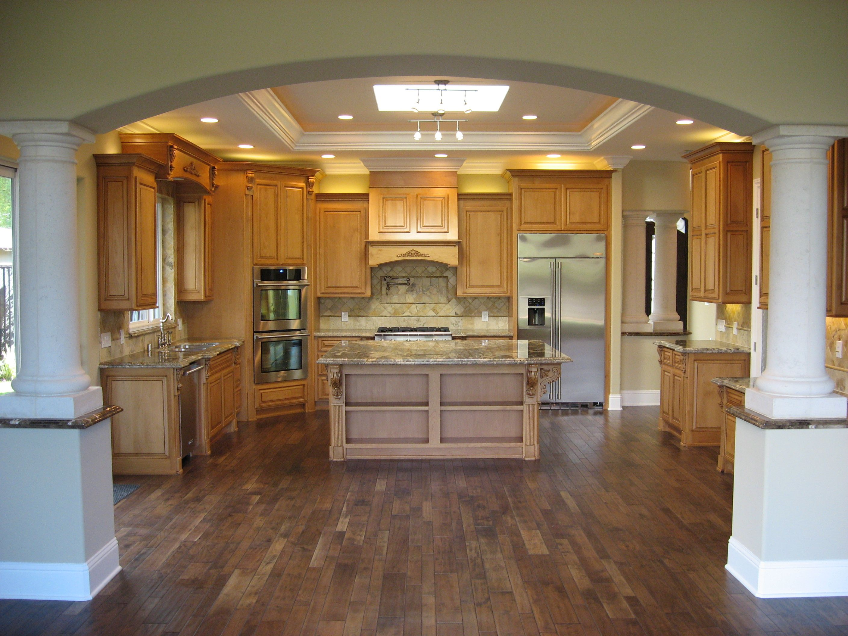 I like how these columns separate the kitchen from the ...