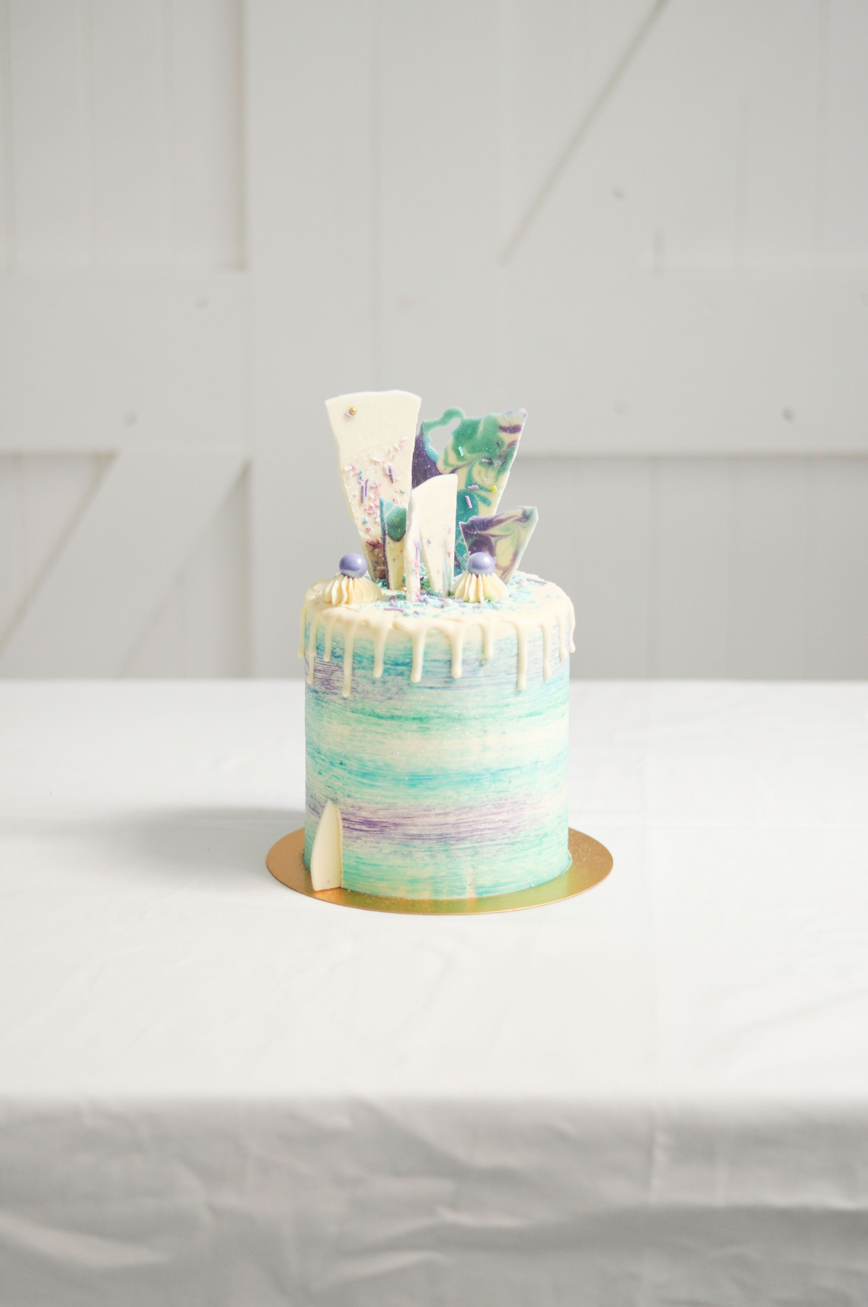 Under the Sea themed buttercream cake with chocolate drip and shards ...