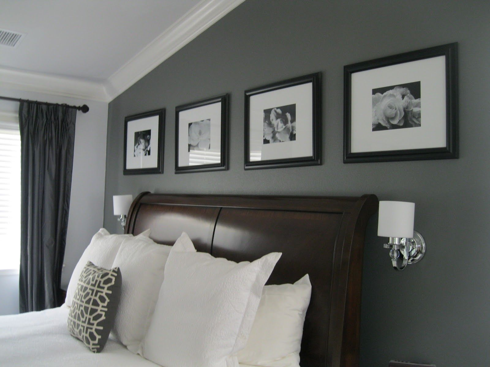 i like the grey accent wall with black picture frames - Grey Interior Paint Schemes