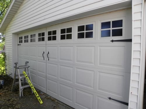 DIY Garage Carriage Door   Paint Faux Windows On Your Garage Door, Line  Done The Middle, Add Handles And Your Have Yourself A Faux Carriage Door.