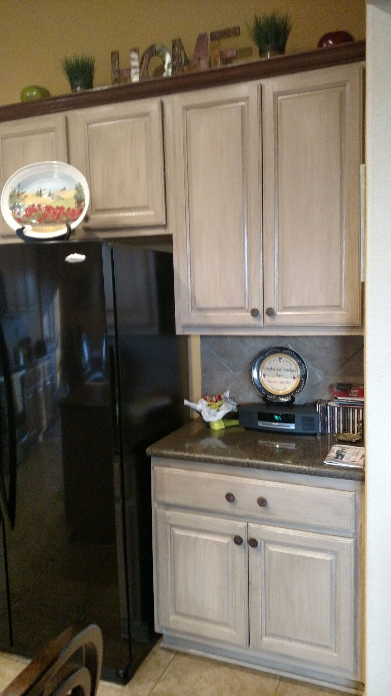 These stained oak cabinets were updated with paint and strie glaze