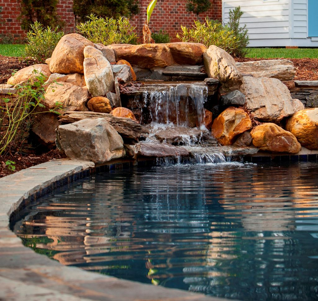 Natural stone waterfall premier pool renovations water for Rock waterfall