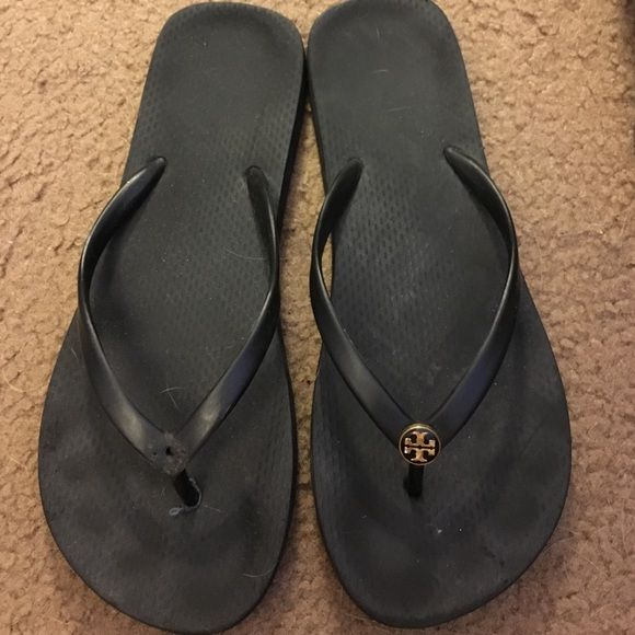 Well worn black Tory flip flops If anyone is looking for a left flip flop with the emblem this is a good fix for you, or if someone has the emblem still and no sandal. I am just posting in case someone's looking for a sandal match like I am. Tory Burch Shoes Sandals