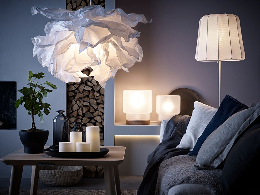 Unique Ikea A living room with a pendant lamp made of crumpled paper a floor lamp with wireless charging and two table lamps with LED bulbs