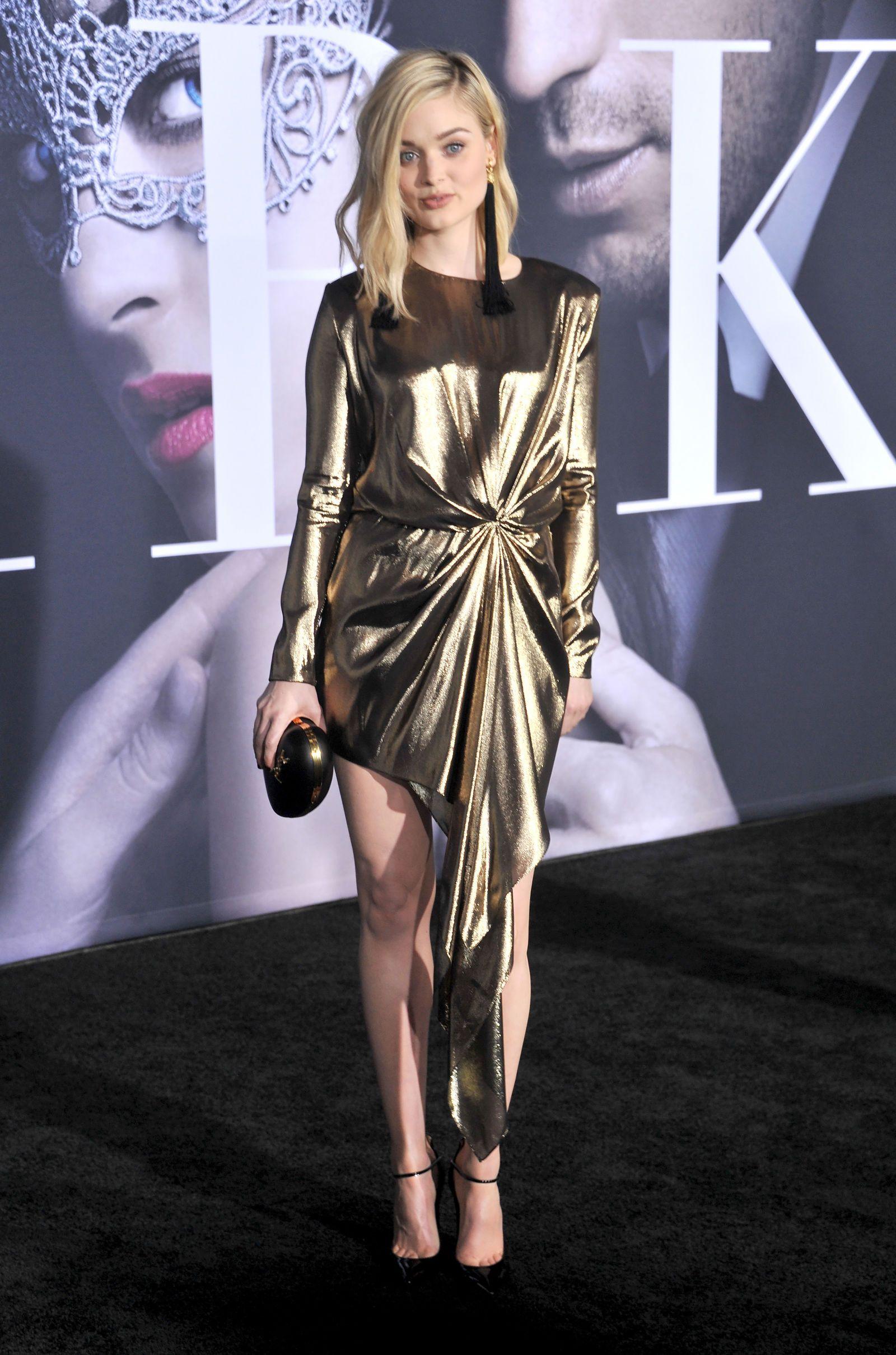Dakota Johnson Wears Silk Sheets, A Lot Of Boob Tape