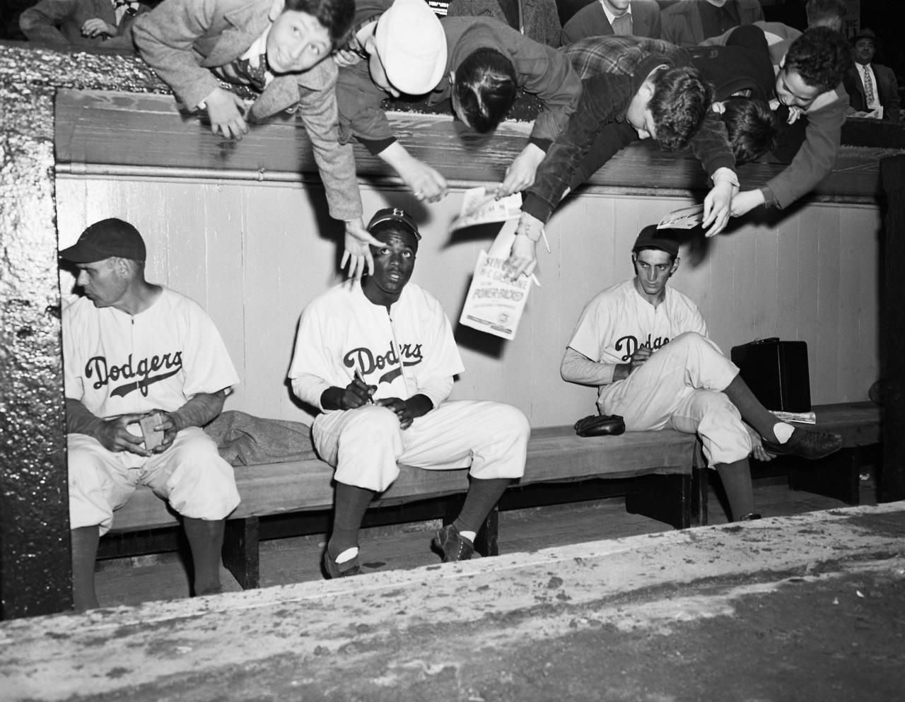 Jackie Robinson signing autographs for the kids in the