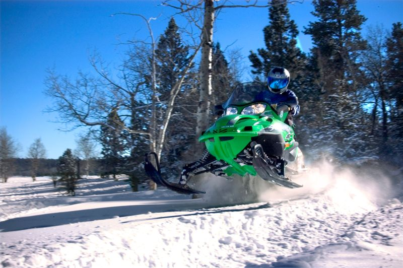 A jump set up on the a snowmobiling trail of the Black